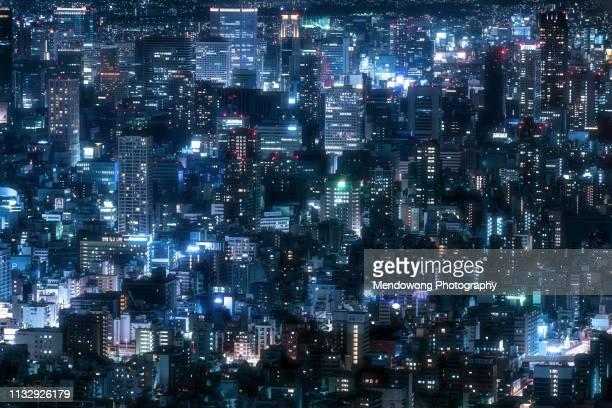 high angle view of illuminated cityscape at night in osaka, japan. - 大阪市 ストックフォトと画像