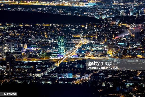 high angle view of illuminated cityscape at night - zurich stock pictures, royalty-free photos & images