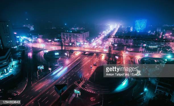 high angle view of illuminated cityscape at night - kiev stock pictures, royalty-free photos & images