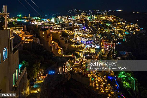high angle view of illuminated cityscape at night - vgenopoulos stock pictures, royalty-free photos & images