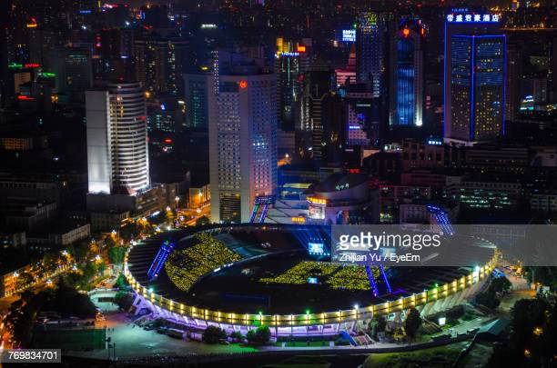 high angle view of illuminated cityscape at night - sports venue stock pictures, royalty-free photos & images
