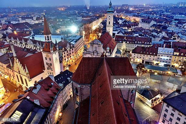 high angle view of illuminated cityscape - munich stock pictures, royalty-free photos & images