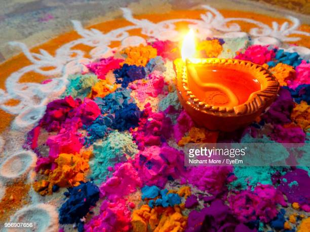 high angle view of illuminated diy on rangoli - diwali stock photos and pictures
