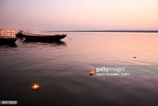 High Angle View Of Illuminated Diyas On Ganges River During Sunrise