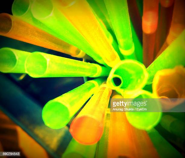 High Angle View Of Illuminated Drinking Straws