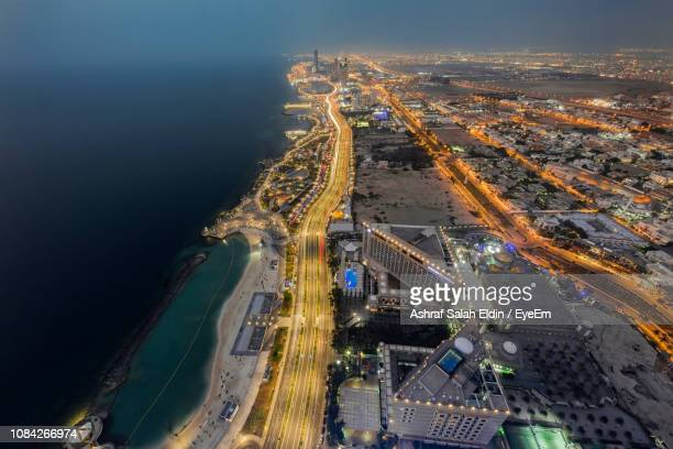 high angle view of illuminated light trails on highway at night - jiddah stock pictures, royalty-free photos & images