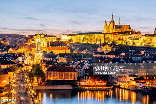 high angle view of illuminated prague skyline at night, czech republic - hradcany castle stock pictures, royalty-free photos & images