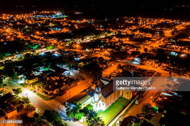 high angle view of illuminated street amidst buildings at night - cordoba argentina stock photos and pictures