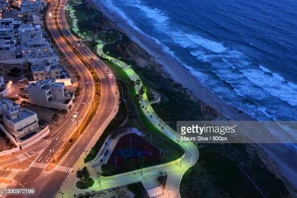 high angle view of illuminated street amidst buildings at night,sderot oved ben ami,netanya,israel - netanya stock pictures, royalty-free photos & images