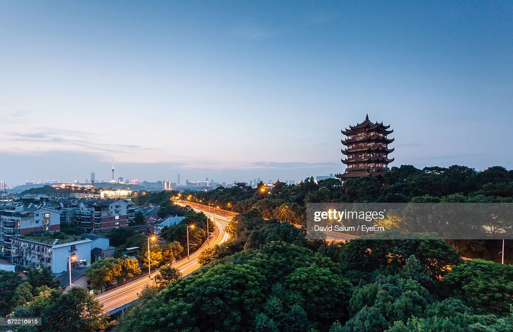 High Angle View Of Illuminated Street And Buildings Against Sky : Stock Photo