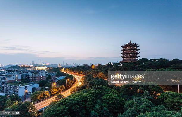 high angle view of illuminated street and buildings against sky - wuhan stock photos and pictures