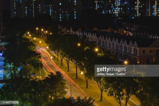 high angle view of illuminated street at night - jeffrey roque stock photos and pictures