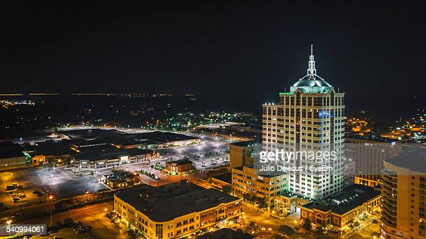 high angle view of illuminated town center against clear sky at night - virginia beach stock photos and pictures