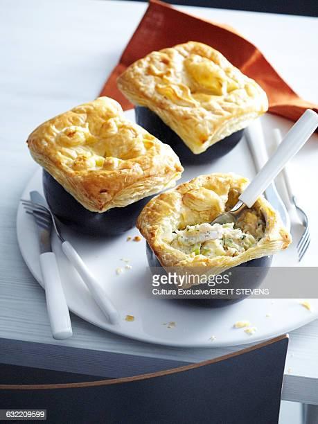 High angle view of individual fish pies