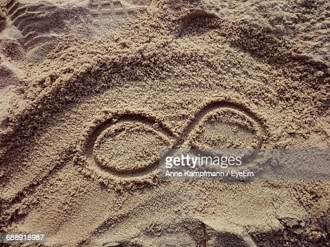 High Angle View Of Infinity Symbol At Sandy Beach Stock Photo