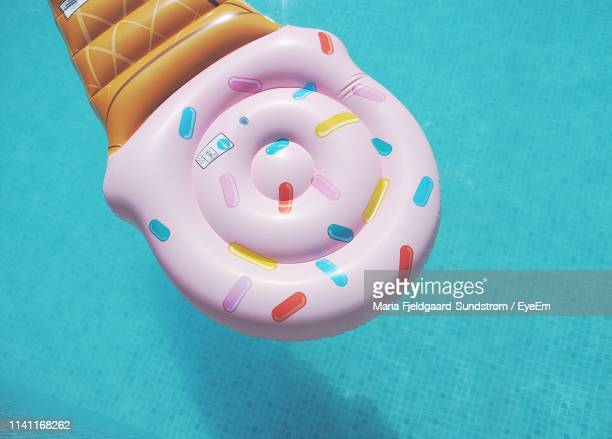 high angle view of inflatable floating on swimming pool - inflatable stock pictures, royalty-free photos & images