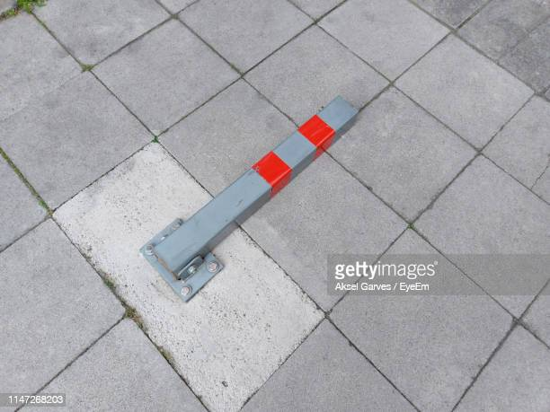 high angle view of information sign on footpath - aksel garves stock-fotos und bilder