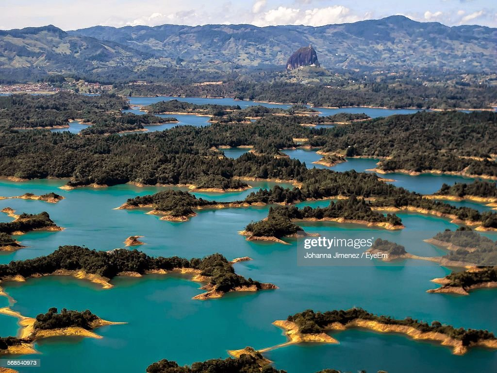 High Angle View Of Inlands With Mountains Seen In Background : Stock Photo