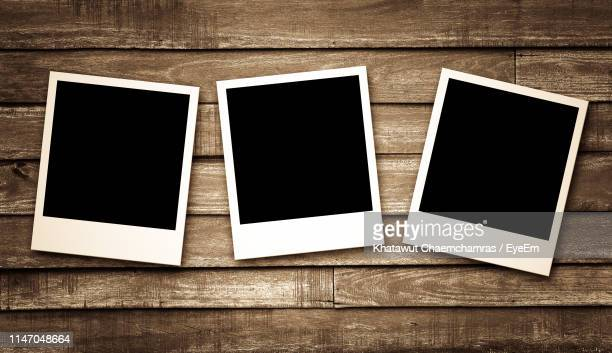 high angle view of instant print transfer - polaroid stock pictures, royalty-free photos & images