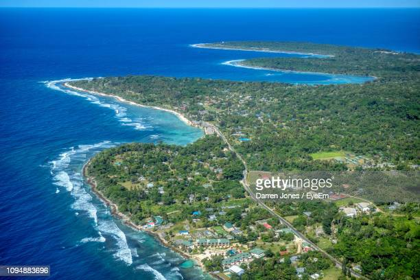 high angle view of island in sea - vanuatu stock pictures, royalty-free photos & images