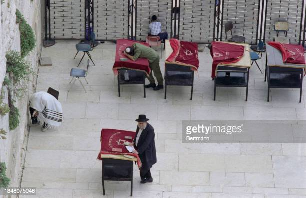 High angle view of Israeli men praying at the Wailing Wall, or Western Wall, an ancient limestone wall on the Temple Mount, a hill in the Old City of...
