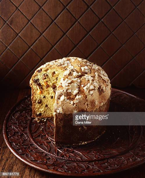 High angle view of Italian panettone on wooden board