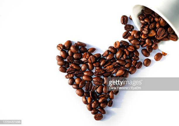 high angle view of italien coffee beans over white background - italien food stock pictures, royalty-free photos & images