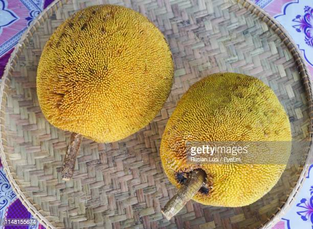 high angle view of jackfruit in wicker basket - jackfruit stock photos and pictures
