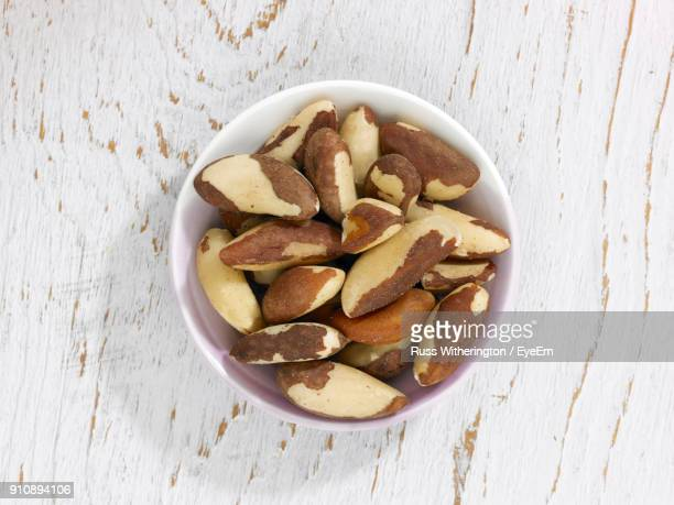 high angle view of jackfruit seeds in bowl on table - jackfruit stock photos and pictures