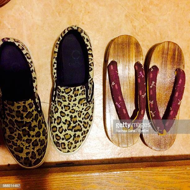 high angle view of japanese flip-flops with leopard print shoe - レオパード柄 ストックフォトと画像