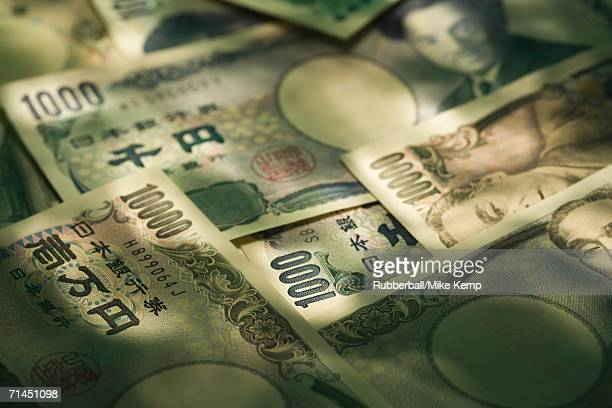 high angle view of japanese yen bank notes - japanese yen note stock photos and pictures