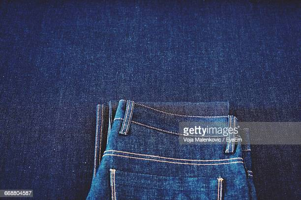 High Angle View Of Jeans On Fabric