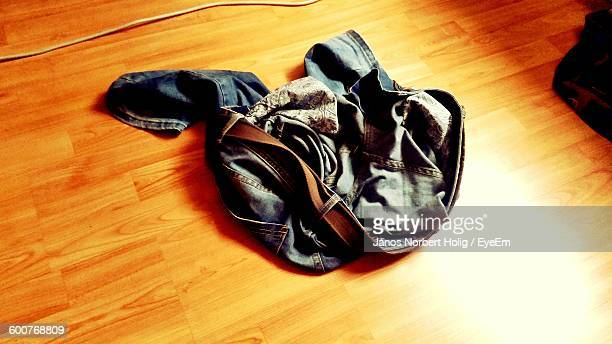 High Angle View Of Jeans On Floorboard At Home