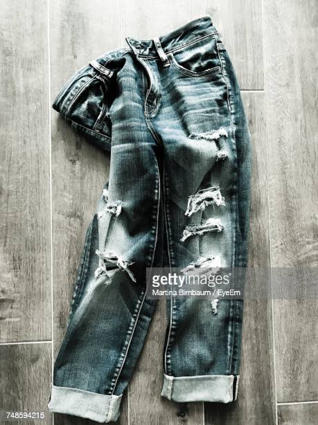 High Angle View Of Jeans On Hardwood Floor