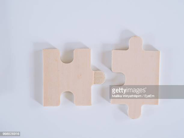 High Angle View Of Jigsaw Pieces Over White Background