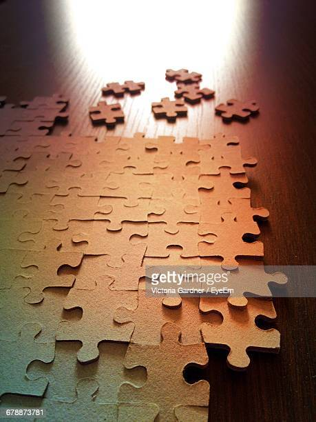 High Angle View Of Jigsaw Puzzle On Table