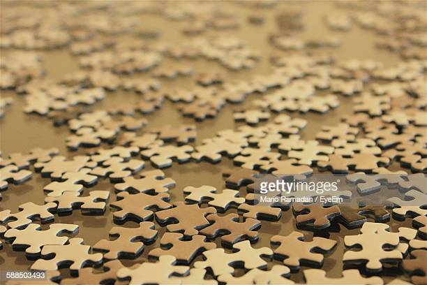 High Angle View Of Jigsaw Puzzles On Floor