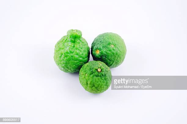 High Angle View Of Kaffir Limes Against White Background