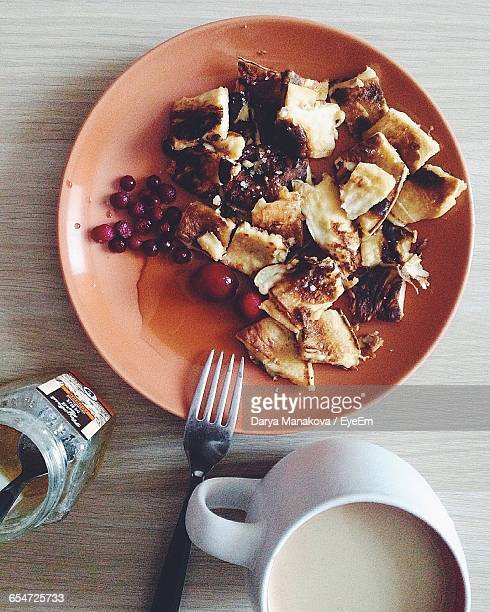 High Angle View Of Kaiserschmarrn With Coffee Served On Table