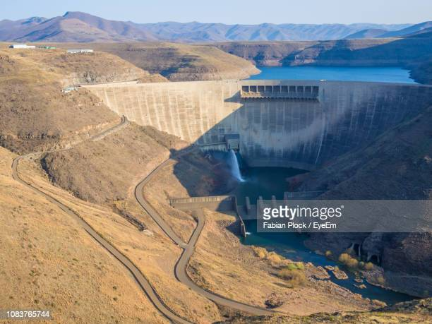 high angle view of katse dam hydroelectric power plant in mountains of lesotho, africa - maseru stock photos and pictures
