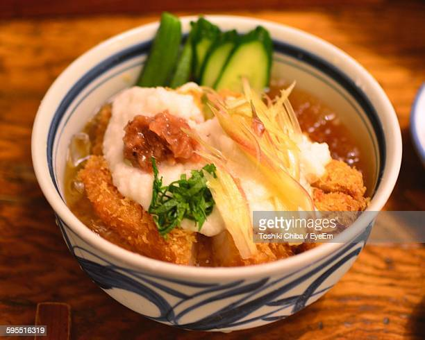 High Angle View Of Katsudon Served In Bowl On Wooden Table