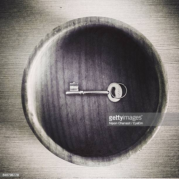 High Angle View Of Key In Wooden Bowl On Table