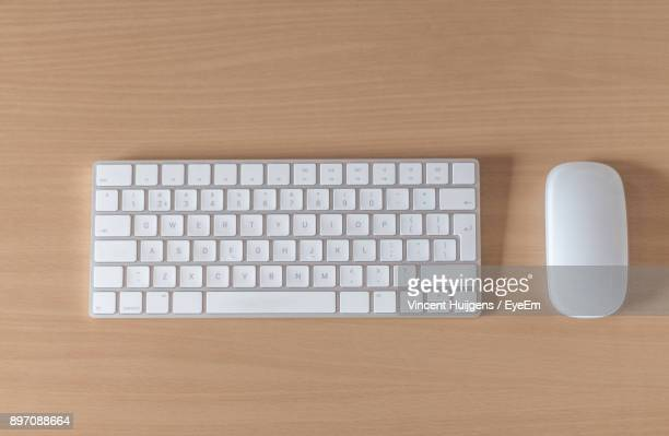 high angle view of keyboard and computer mouse on table - computer keyboard stock pictures, royalty-free photos & images