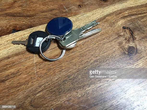High Angle View Of Keys On Wooden Table