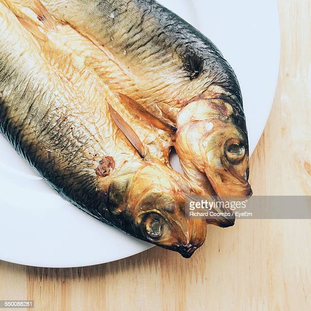 High Angle View Of Kipper Fish In Plate On Table