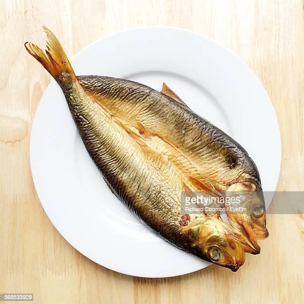 High Angle View Of Kipper Served In Plate On Table