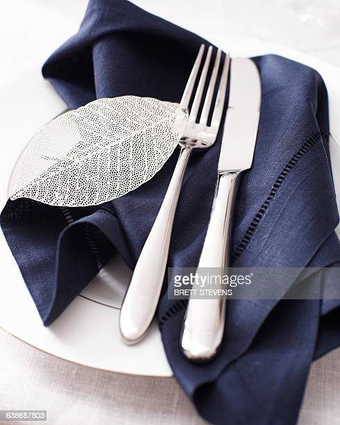 High angle view of knife fork and napkin on place setting