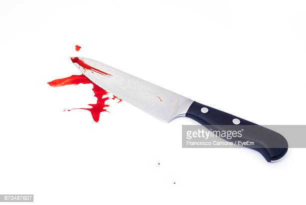 High Angle View Of Knife With Blood On White Background