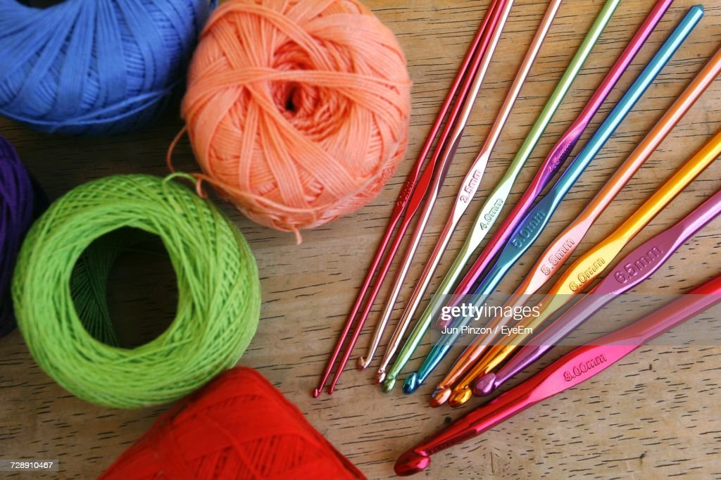 High Angle View Of Knitting Needles On Table : Stock Photo