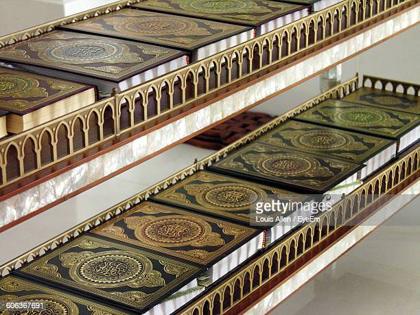 high angle view of koran arranged in shelf - holy quran stock pictures, royalty-free photos & images